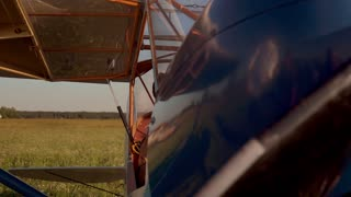 Girl controlling an old airplane
