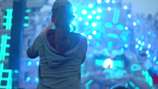 Girl in the concert crowd recording a video