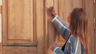 Girl knocking the door in despair