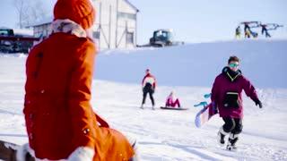 Girl meeting her boyfriend ski resort