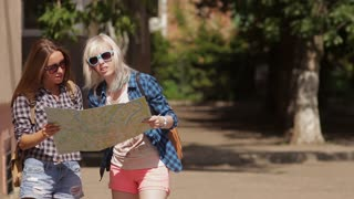 Girls Traveling with map
