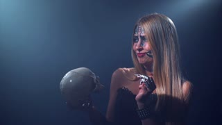 Halloween Woman talking with skull