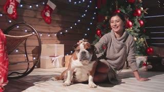 Happy asian girl and bulldog at Christmas