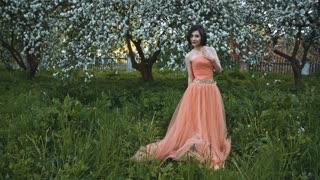 Happy beautiful asian girl in pink dress