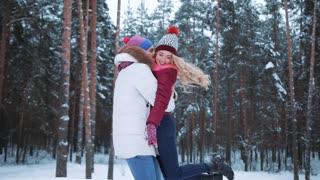 Happy winter travel couple having fun