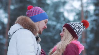 Happy winter travel couple laughing