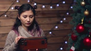 Happy woman Opening a Present magic Box