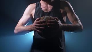 Headless basketball player with a ball
