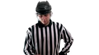 Hockey referee hold a puck in his palm