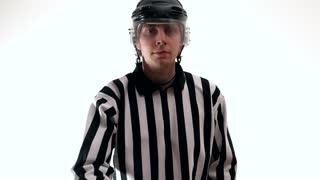 hockey referee referee demonstrate hockey puck