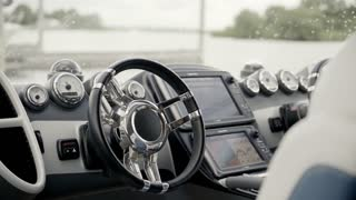 Instrument panel and a wheel of a motor boat yacht