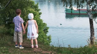 kids standing near the river outside