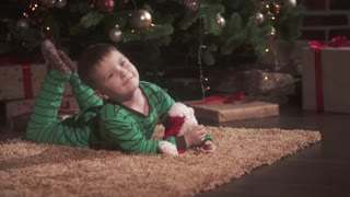 little cute boy with Christmas gifts