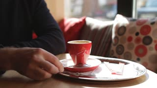 man at cafe drinking coffee