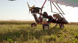 Man getting onto an ultralight trike, airplane
