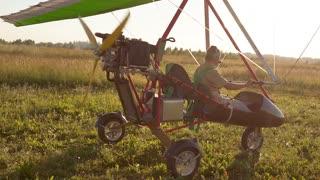 Man riding an ultralight trike, airplane