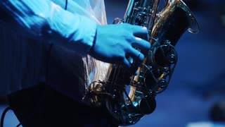 musician plays at saxophone in gig