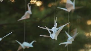 Origami cranes in summer nature
