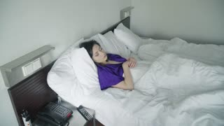 Restless dreams of sleeping woman