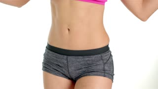 Slim girl with centimeter on white background
