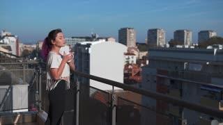 Sporty woman enjoying her morning coffee
