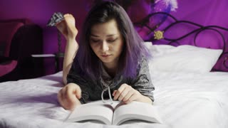 Teenage Girl Reading on Bed