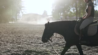 A woman exersicing in horse riding