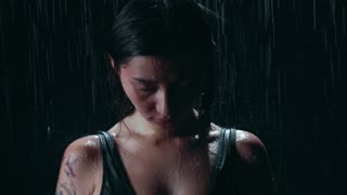An expressive female portrait and water falling