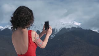 Asian girl with a phone in winter landscape