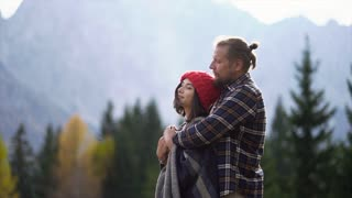 Attractive couple hugging in the mountains