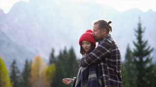Attractive couple in love in the mountains