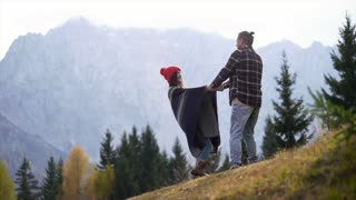 Attractive happy couple in love in the mountains