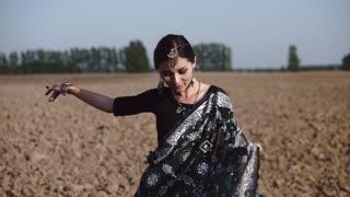 Beautiful Indian girl dancing in sari