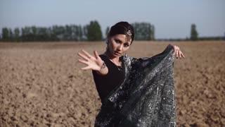 Beautiful Indian woman dancing in sari