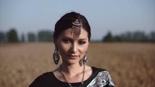 Beautiful Indian woman smiling and posing
