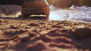 Closeup of car drifting in winter