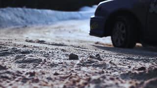 Closeup of car tires drifting in snowy winter