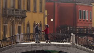 Couple in Venice, love on a bridge