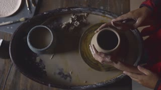 Couple making clay jug, love concept