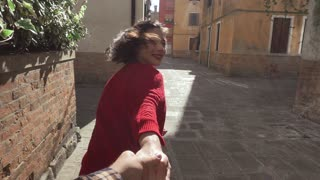 Follow me - happy young woman in Venice