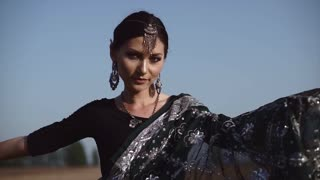 Gorgeous Indian woman dancing in sari