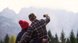 Hispanic couple taking selfie in the mountains