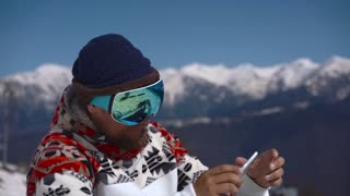 Snowboarder taking pics on the phone