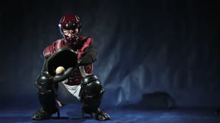 Teenage baseball player catch a ball