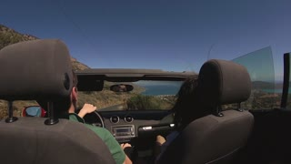 The young couple in the cabriolet