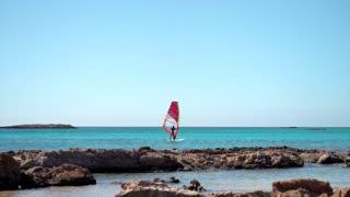 Windsurfer Surfing The Wind On sea Waves
