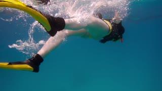 Woman free diving in red sea