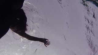 Woman free diving in sea