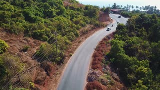 Young biker couple landing drone, Indian road