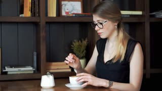 young woman is disgusted by the taste of her coffee